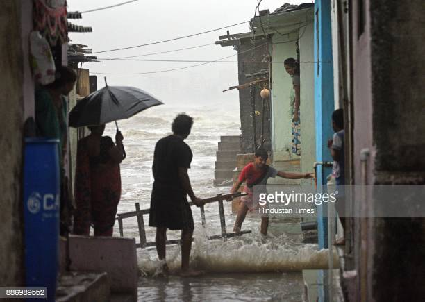 Arabian Sea waves of 435 meters height entered in slum near to seashore of Bandstand at Bandra due to cyclone Okhi on December 5 2017 in Mumbai India...