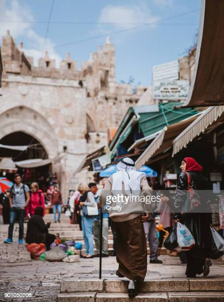 arabias walking in old town of jerusalem - east jerusalem stock pictures, royalty-free photos & images