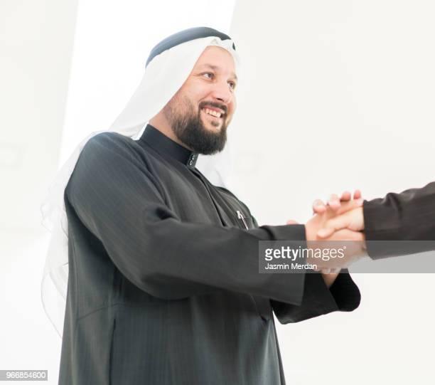 Arabic adult man to handshake
