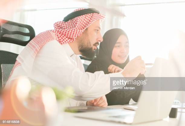 Arabic business male and female working together on project