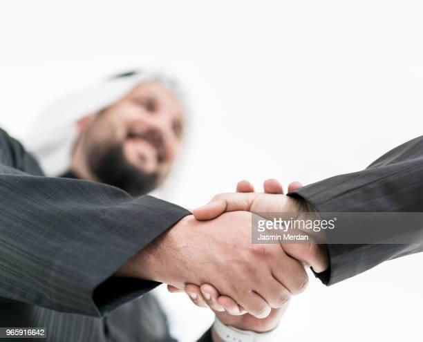 arabic businessman handshake - bahrain stock pictures, royalty-free photos & images