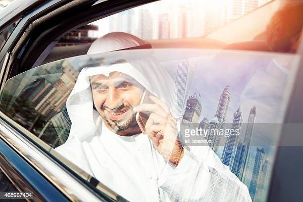 Arabic businessman on phone in car,Dubai