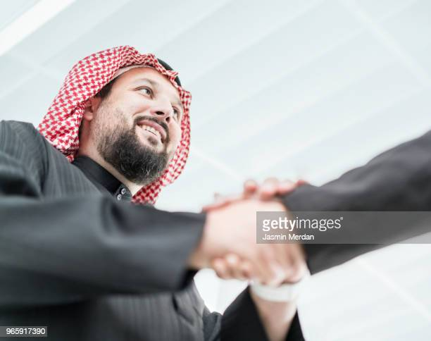 Arabic businessmen shaking hands