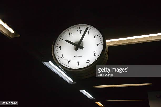 arabic clock in metro station, cairo, egypt - jake warga fotografías e imágenes de stock
