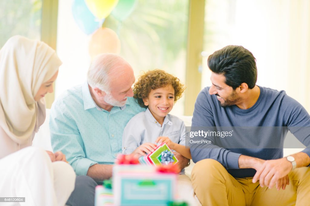 Arabic family birthday exchanging gifts : Stock Photo