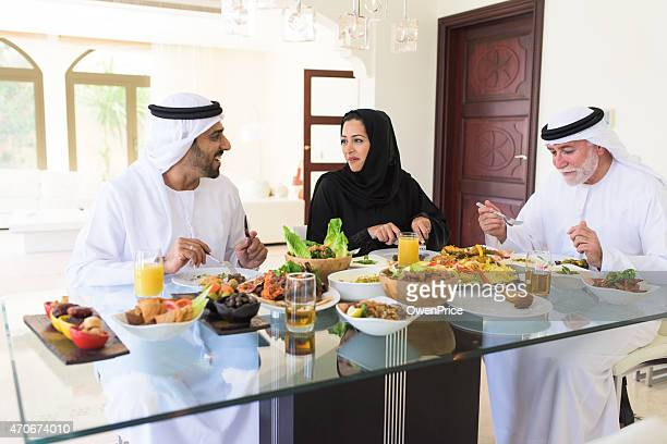arabic family enjoying lunch - ramadan stock pictures, royalty-free photos & images