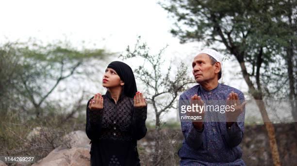 arabic father & daughter praying to god or muslim namaj time - salah islamic prayer stock pictures, royalty-free photos & images