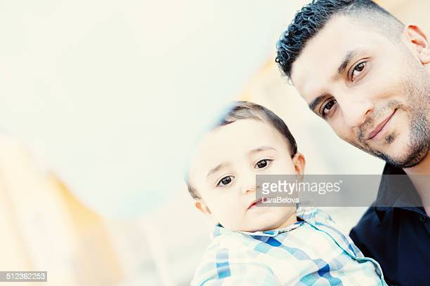 Arabic father with his little son