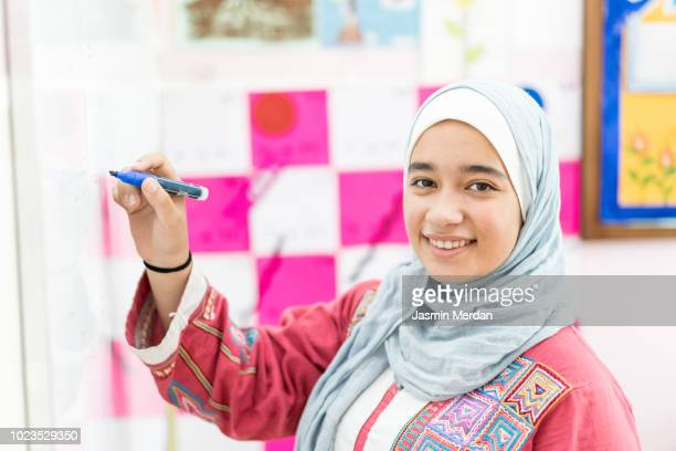 arabic female in school - jordan middle east stock pictures, royalty-free photos & images