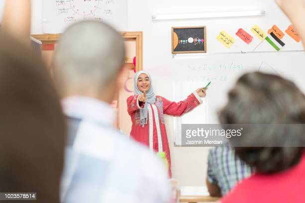 arabic female teacher in school - jordanian workforce stock pictures, royalty-free photos & images