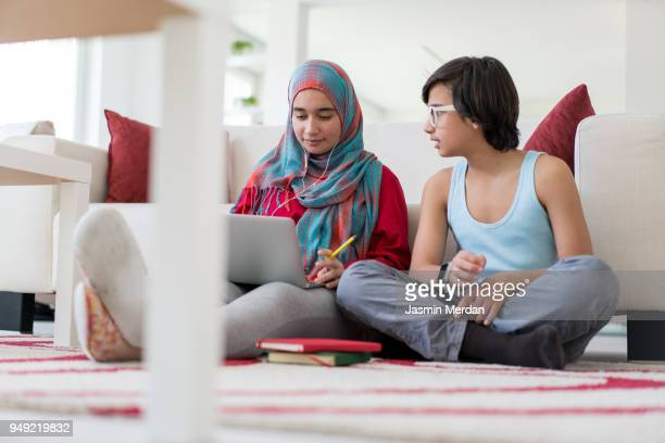 Arabic girl and boy studying at home