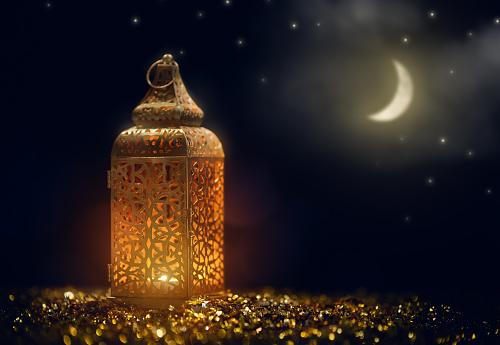 Arabic lantern with burning candle 1139470545