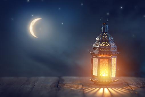 Arabic lantern with burning candle 1139470551