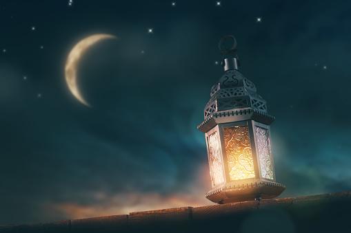 Arabic lantern with burning candle 1213501614
