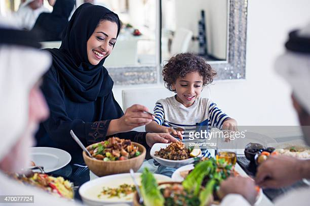 arabic lunch time - two generation family stock pictures, royalty-free photos & images