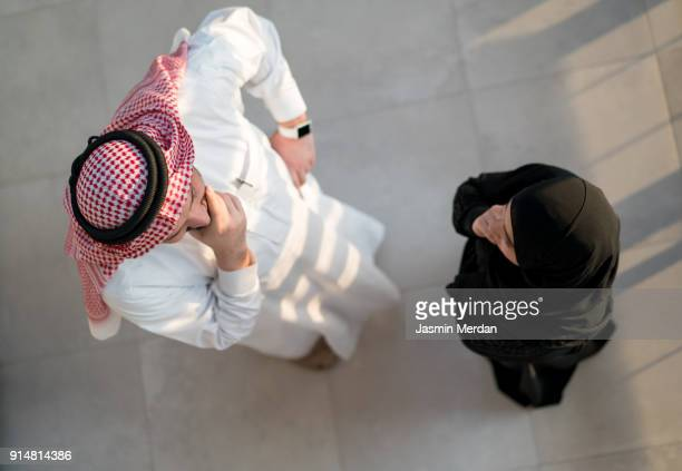 arabic male and female top view - man in dress stock photos and pictures