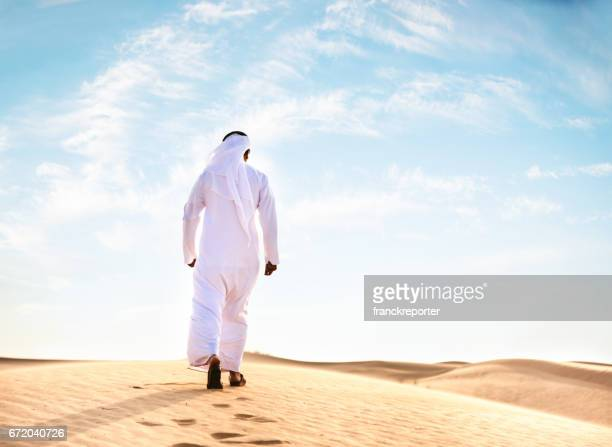 arabic man praying in the desert