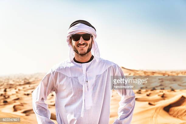 arabic man smiling on the desert - kaffiyeh stock pictures, royalty-free photos & images