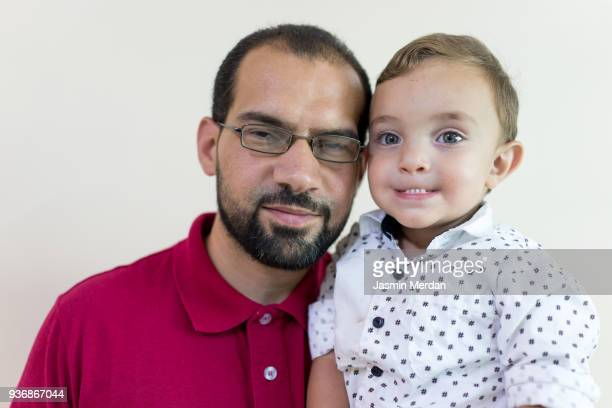 Arabic man with baby son