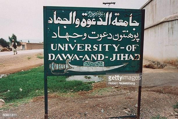 Arabic, Pushtu & English Univ. Of Dawat & Jihad campus sign, aka Al-Dawat, univ. Founded & run by militant Afghan Muslim ldr. Abdul Rasool Sayyaf,...