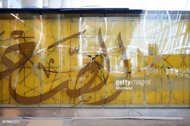 Arabic script decorates the glass wall of a boarding gate at Abu Dhabi airport's MidField terminal during construction in Abu Dhabi United Arab...