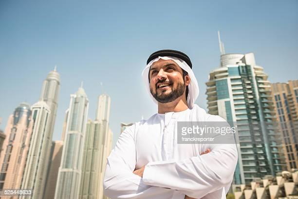 arabic sheik portrait laughing on dubai marina