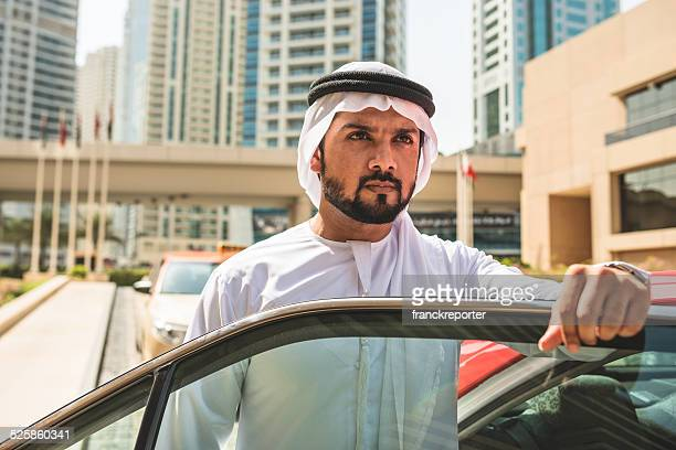 arabic sheik standing outside the taxi