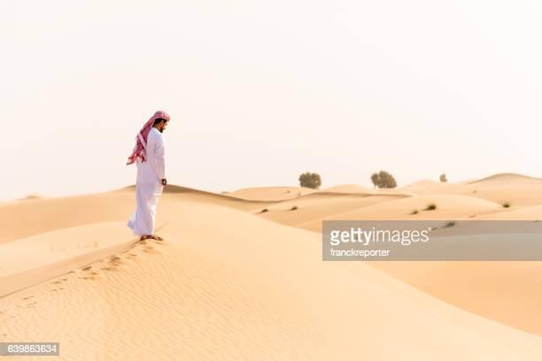 arabic sheik walking on the desert