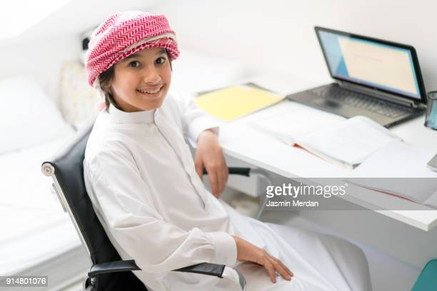Arabic teenage boy doing homework
