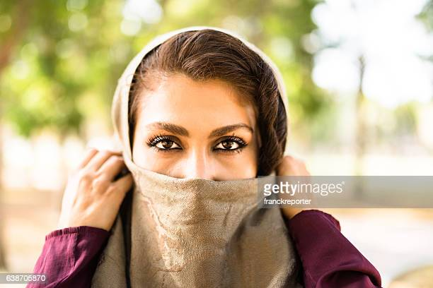 arabic woman in the park in abu dhabi - uae