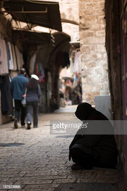 arabic woman sitting on street - jerusalem old city stock pictures, royalty-free photos & images