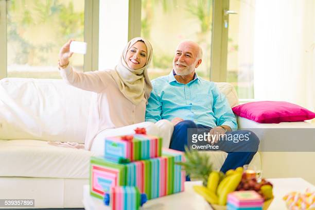 Arabic woman taking a selfie with her farther