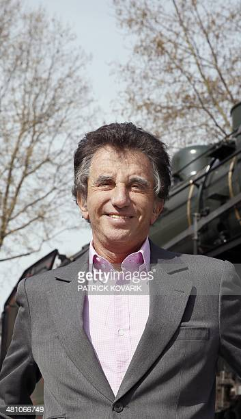 Arabic World Institute president Jack Lang poses on March 28 2014 in Paris in front of the locomotive of the legendary train the Orient Express which...