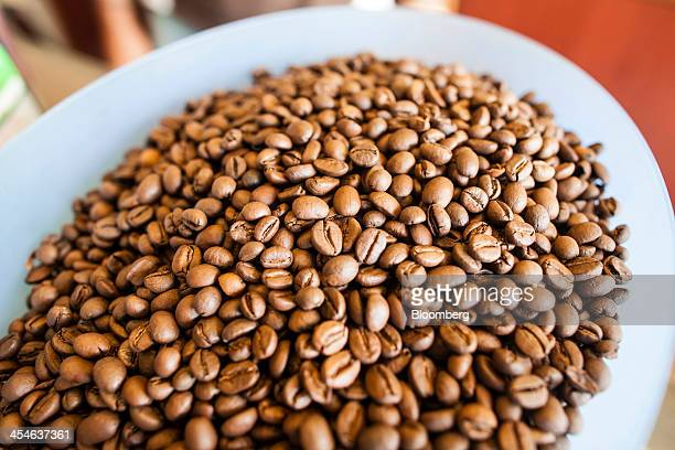 Arabica coffee beans are displayed for sale at a store in Madikeri Karnataka India on Tuesday Dec 3 2013 Strong monsoon rainfall in India will cut...