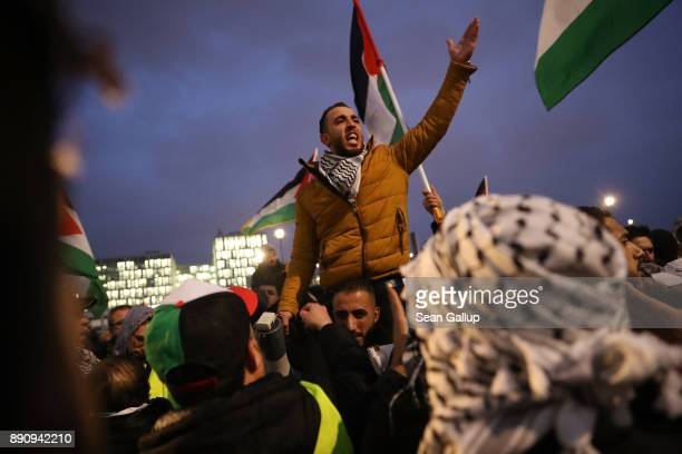 Arabicspeaking protesters attend a gathering to protest against the recent announcemment by US President Donald Trump to recognize Jerusalem as the...