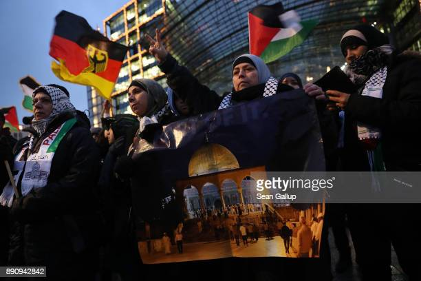 Arabicspeaking protesters including a woman holding a photograph of the Dome of the Rock in Jerusalem attend a gathering to protest against the...