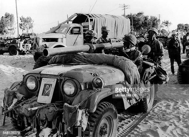 1967 ArabIsraeli War Israeli soldiers in the area of the Gaza Strip / the Sinai attached to the front of the jeep is a photo of GA Nasser 661967