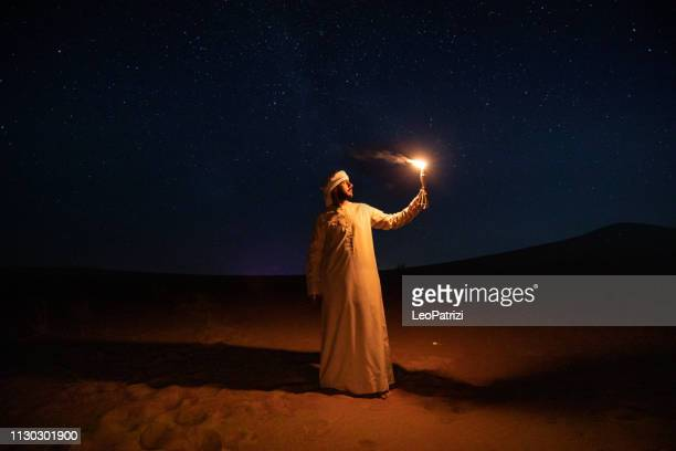 arabs camping at night in the desert - culture stock pictures, royalty-free photos & images