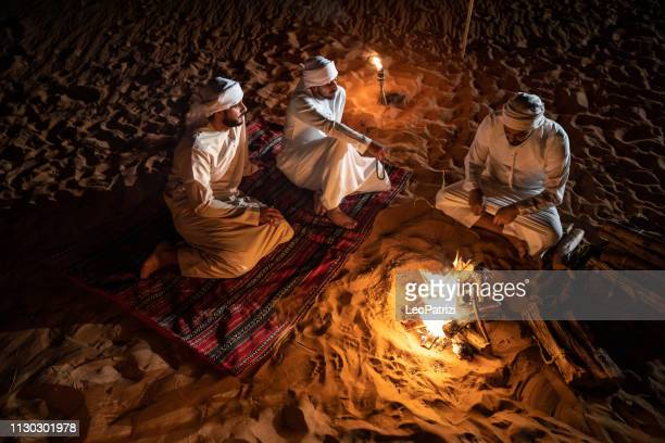 arabs camping at night in the desert - united arab emirates stock pictures, royalty-free photos & images
