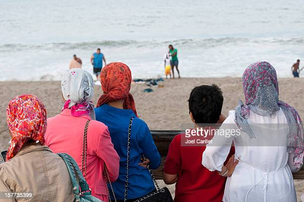 arabs in america - muslim woman beach stock photos and pictures