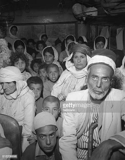 Arabs mostly old men women and children stare in stoney silence at the camera They were among more than 1500 Arab refugees from captured villages who...