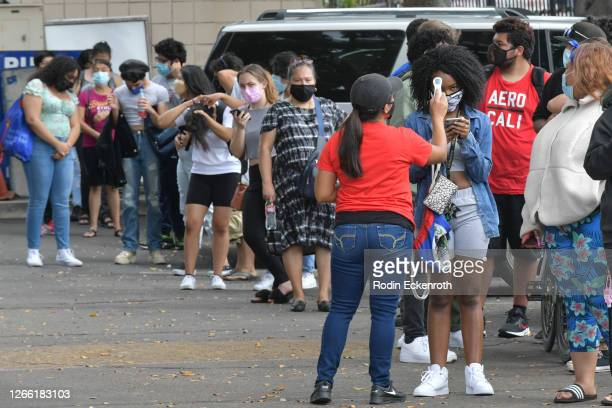 Aracelia Gasper Andres performs a contactless temperature check at Hollywood High School on August 13 2020 in Hollywood California With over 734000...