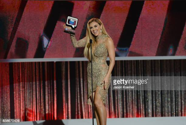 Aracely Arambula accepts award on stage at Telemundo's 2017 Premios Tu Mundo at American Airlines Arena on August 24 2017 in Miami Florida
