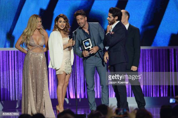 Aracely Arambula Danna Paola David Chocarro and Jose Maria Galeano on stage at Telemundo's 2017 Premios Tu Mundo at American Airlines Arena on August...