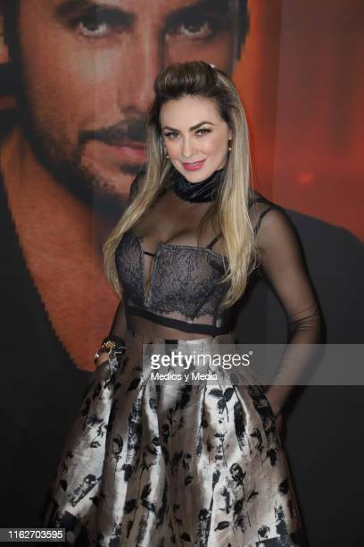 Aracely Arambula poses for photos on the red carpet for the 'Jesucristo Superestrella' premiere at Centro Cultural 1 on July 17 2019 in Mexico City...