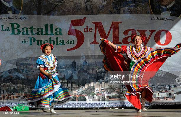 Aracely Saucillo and Marylin Castillo perform with Mexica Ballet Folclorico performs during Cinco De Mayo festivities on May 5 2011 at El Pueblo de...