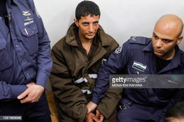 TOPSHOT Arafat Irfaiya a 29yearold Palestinian suspected of killing a young Israeli woman is seen in Israeli custody at the Magistrate's Court in...