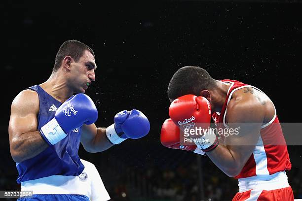 Arajik Marutjan of Germany fights Gabriel Maestre of Venezuela in their Mens 69kjg Welterweight bout on Day 3 of the Rio 2016 Olympic Games at the...