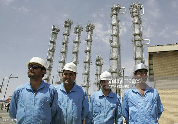 Iranian employees pose for a picture at the newly opened heavy water plant in Arak 320 kms south of Tehran 26 August 2006 Iranian President Mahmoud...