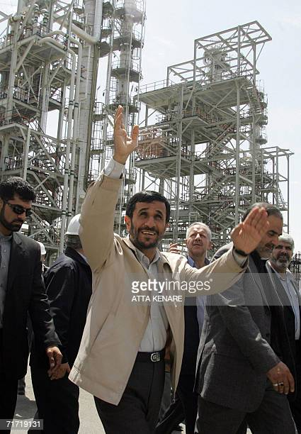 Iranian President Mahmoud Ahmadinejad waves during the opening ceremony of a heavy water plant in Arak 320 kms south of Tehran 26 August 2006...